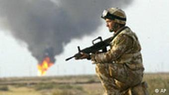 A member of 3 Regiment Army Air Corps, serving with the British Army's 16 Air Assault Brigade, keeps watch Saturday March 22, 2003, after securing the North Ramala oilfield in Iraq.
