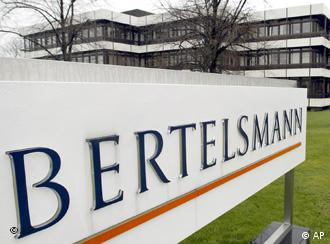 Three story building with Bertelsmann sign in foreground