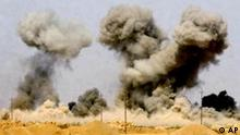 Smoke rises after bombs are dropped on an arms cache used by militia fighters roughly 100 miles south of Baghdad, near Ad Diwaniyah, Iraq, Thursday, March 27, 2003. (AP Photo/The Baltimore Sun, John Makely)
