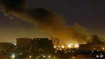 Smoke bellows from a large explosion that rocked Baghdad, Iraq during air raids early Monday March 31, 2003.