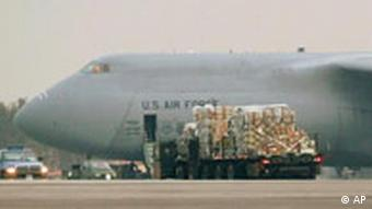 A truck loaded with supplies rolls towards an USAF C-5 Galaxy cargo plane at the U.S. airbase in Ramstein, southwestern Germany, Tuesday March 25, 2003. The airbase is an important turnover venue for airborne supply for U.S. forces in the gulf region engaged in operation Iraqi Freedom.. (AP Photo/Thomas Kienzle)