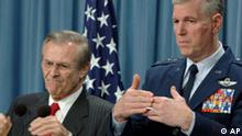Defense Secretary Donald Rumsfeld, left, during a news conference at the Pentagon Friday, March 28, 2003 with Chairman of the Joint Chiefs of Staff Gen. Richard Myers, right, issued a stern warning to Syria on sending military equipment, such as night vision goggles, to equip Iraqi forces. (AP Photo/Dennis Cook)