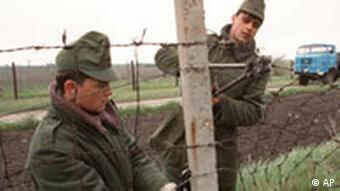 Hungarian borderguards dismantling the Iron Curtain