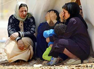 Unidentified women who fled with their families from Iraq at a refugee camp in Jordan