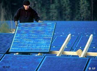 A man installs a solar panel on a roof