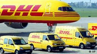 A DHL airplane and vans