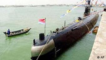 A Chinese Navy submarine is docked at a PLA navy base in Qingdao, China
