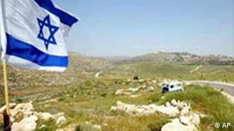 An Israeli flag flying outside a settlement in the West Bank