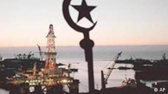 A silhouette of the Azerbaijan national emblem is seen over the Neftyanye Kamny, Oil Stones, oil rigs at the shore of the Kaspian Sea in Baku, Azerbaijan, Oct. 13, 1998. The former Soviet republic of Azerbaijan is reportedly sitting on billions of tons of Caspian oil. But development has been slow, and the absence of a major export pipeline has keep most of the country's 7.5 million people in poverty. Jobs are scarce and monthly salaries rarely exceed 170,000 manat ($43).