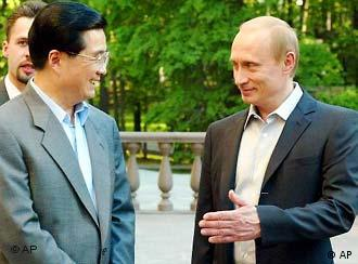 Russian President Vladimir Putin, right, and his Chinese counterpart Hu Jintao speak prior to an informal dinner at Putin's residence in Novo-Ogaryovo outside Moscow, Monday, May 26, 2003. Chinese President Hu Jintao arrived in Russia on Monday on his first trip abroad since his ascension to power - a visit intended to underline the importance of the two nations' so-called strategic partnership and help forge closer economic ties. (AP Photo/ Ivan Sekretarev, Pool)