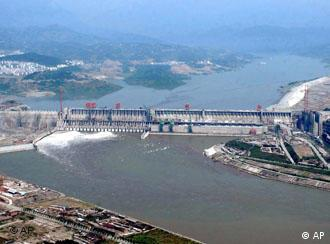 This photo taken on Tuesday, June 3, 2003 shows the Three Gorges Reservoir on the middle reaches of the Yangtze River at Yichang, Hubei province. The water level reached, as planned, 114.29 meters high on the sluice gate at Tuesday. (AP Photo/ Xinhua, Cheng Min)