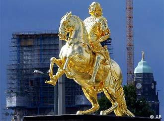 The city's Golden Rider statue shines again