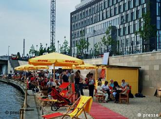The 'Federal Press Beach' is wedged between Germany's national press building and the Spree.