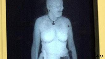 Susan Hallowell, the director of the BritishTransportation Security Administration's security laboratory, allows her body to be X-rayed by the backscatter machine