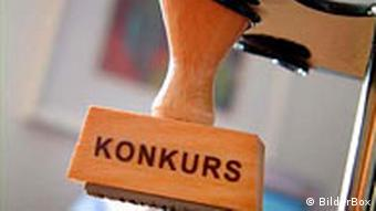 Konkurs Stempel Symbolbild