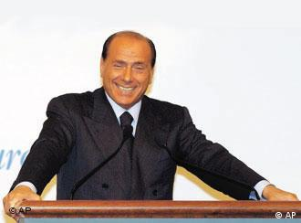 Italian Prime Minister Silvio Berlusconi is all smiles and not one bit apologetic on Friday.