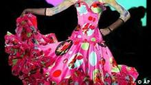 A model wears a creation by British fashion designer John Galliano for Dior' s Haute Couture fall-winter 2003/2004 collection presented in Paris, Monday, July 7, 2003. (AP Photo/Michel Euler)