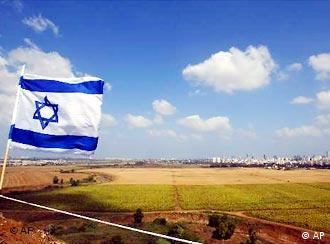 An Israeli flag flies over the Ayalon Park in the outskirts of the city of Tel Aviv