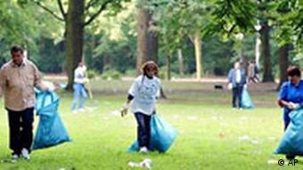Workers cleaning a park