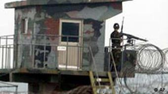 A South Korean soldier stands guard in Paju. Both sides have to be alert at all times