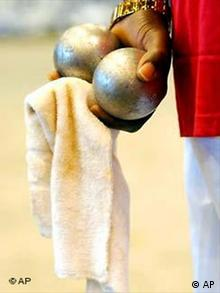 Man holding a pair of boules