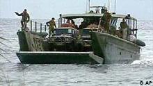 Australian Navy landing craft approaches Red Beach, near Honiara, Solomon Islands, video still
