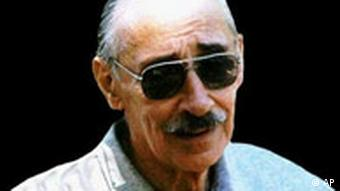 An aged Videla wearing sunglasses