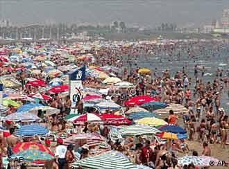 Crowds flock to a beach in Valencia in southeastern Spain