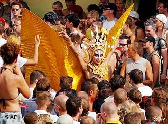 Parade-goers admire a golden costume at a past parade