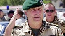 Lt-Gen. Goetz F.E. Gliemeroth, new Commander of ISAF, salutes as he arrives for the handover ceremony of commanding force from ISAF to NATO in Kabul, Afghanistan Monday, Aug. 11, 2003. NATO took command of the 5,000-strong international peacekeeping force in the Afghan capital on Monday, a historic move that marks the alliance's first operation outside Europe since it was created 54 years ago. (AP Photo/Apichart Weerawong)