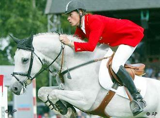 Christian Ahlmann on horse Coester crosses the obstacle during the second round of the the second jumping competition over two rounds for individual and team during the European Championships of the riders in 2003