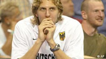Nowitzki, benched with a bum foot, watches the German team play Italy, on Sunday 31. Aug. 2003.