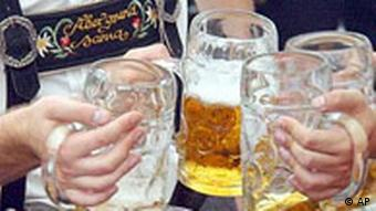 Visitors lift their beersteins at the Oktoberfest