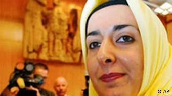 Afghanistan-born muslim teacher Fereshta Ludin prior to the proclamation of the verdict of the German Constitutional Court on Wednesday, Sept. 24, 2003. The court ruled that the state of Baden-Wuerttemberg cannot forbid Ludin from wearing a headscarf in classroom under current law.