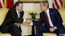 ** BILD DER WOCHE -- INTERNATIONAL ** One day after the opening of the 58th Session of the United Nations General Assembly, President Bush meets with German Chancellor Gerhard Schroeder at the Waldorf-Astoria Hotel in New York, Wednesday, Sept. 24, 2003. It is the first direct meeting, and handshake, between the allies since Germany opposed the U.S. invasion of Iraq. (AP Photo/J. Scott Applewhite)