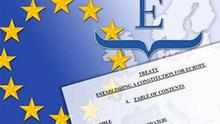 EU symbol over European Convention logo and Draft Treaty on Constitution for Europe, partial graphic