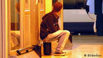 A lone man at a station in Germany